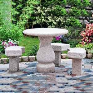 Granite table and curved chairs set outdoor for park