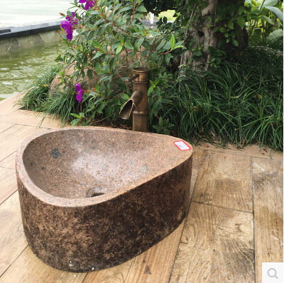 One-hundred-stone-sink-basin-natural-stone-sinks-art-pebbles-on-restoring-ancient-ways-of-the