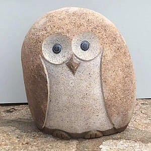 Decorative cobble stone owls carving statues
